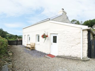 TALIHARRIS COTTAGE, 16th century cottage, one double bedroom, dogs welcone, near
