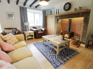 THE COTTAGES, spacious accommodation, three bedrooms, wood burner, lawned garden