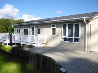 ORCHID LODGE, open plan layout, decked area with furniture, on holiday park, in