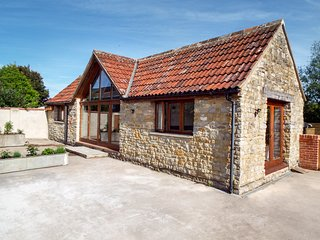 THE STONE BARN, barn conversion, large gardens, open plan, near Shepton Mallet