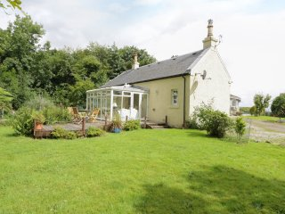 KEVINGTON COTTAGE, sitting room with woodburning stove, conservatory, garden, co