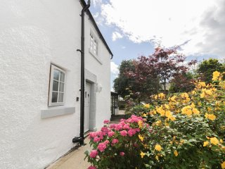WHITEHALL COTTAGE, upside down accommodation with views over garden, WiFi, locka