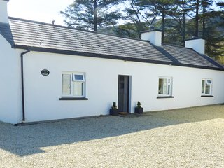 DENIS'S COTTAGE, all ground floor, woodburning stove, parking, gravel garden, in