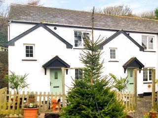 MARTIN COTTAGE, semi-detached, on working farm, shared private beach, in