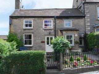 CARTMEL COTTAGE, pet-friendly, country holiday cottage, with a garden in