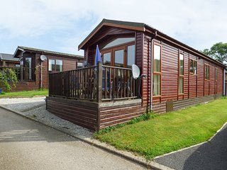 CHERRY TREE LODGE, wooden holiday lodge, all ground floor, parking, patio garden