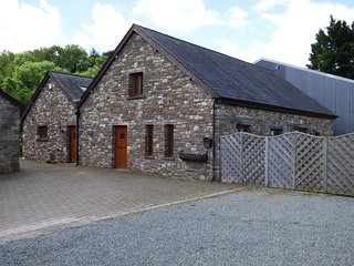 RIVERSIDE BARN, stylish cottage with garden, paddock, games room, close