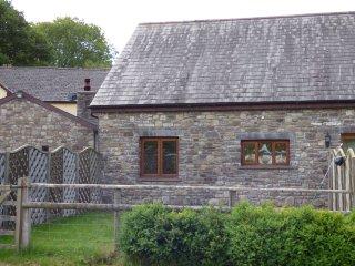 RIVERSIDE BARN, stylish cottage with garden, paddock, games room, close walking,