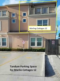 Two vehicles may be parked in tandem at Marlin Cottages 12.