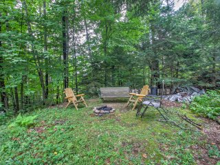 Spend an evening by the fire pit at this 3-bedroom, 2-bath cabin.