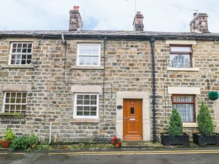 WINN COTTAGE, centre of Pateley Bridge, exposed wooden beams, traditional fire,