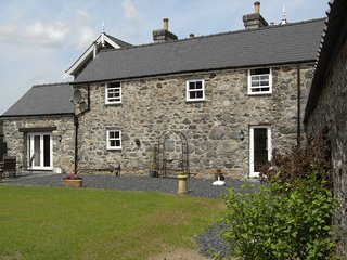Y BWYTHYN AT HENFAES stone-built detached cottage, rural village, views, Dolgell