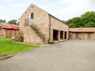 THE STABLES, CRAYKE LODGE, first floor barn conversion, WiFi, woodburner