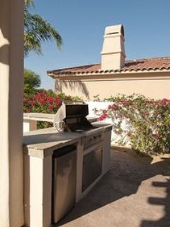 OUR BBQ & OUTSIDE FRIDGE IS CONNECTED TO OUR SIT UP BAR WITH THOSE FANTASTIC VIEWS OF THE DESERT.