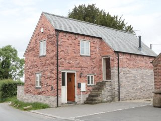 WOODSIDE BARN, detached, pet-friendly barn conversion, woodburning stove, enclos
