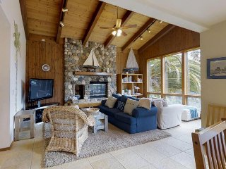 Spacious, creekside home with gourmet kitchen, rock-face fireplace, & deck