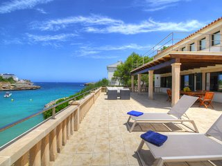 VILLA COLOM. With direct access to the beach and the sea.