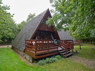 The cabin is on a private estate surrounding by trees.