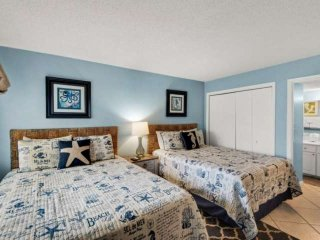 The bedroom offers two Queen beds!