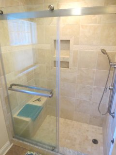 It has a beautiful new glass door, step-in shower with a handy bench seat.