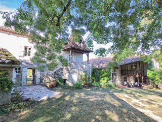 A wonderful stone farmhouse and converted barn with large pool and tennis court