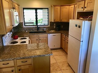 Upgraded, fully equipped kitchen with granite countertops
