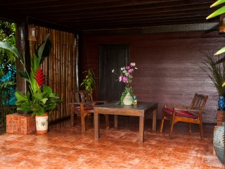 The covered alfresco living area creates a shady space for relaxing and enjoying the flora and fauna