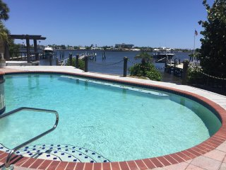 WOW Amazing Waterfront Resort Style Living Large 4 Bedroom home on 1/2 an acre!