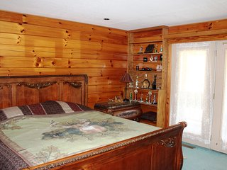 Master Bedroom with french doors leading to deck and a tremendous view