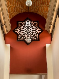 High brick dome ceiling with Mexican iron star that lights up at night in main entrance way