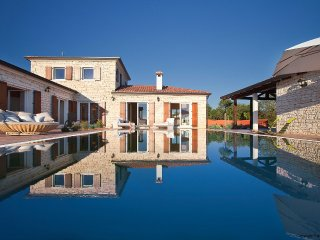 Villa Modena is a gorgeous villa with a pool and a large garden