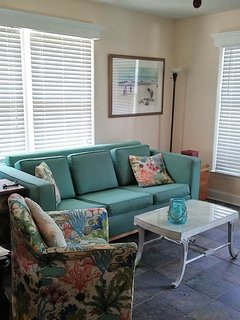 living room with queen pull-out sofa