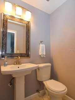 Half bath located near pool and eat in kitchen.
