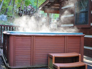 Private hot tub on back porch, steaming in the cool mountain air