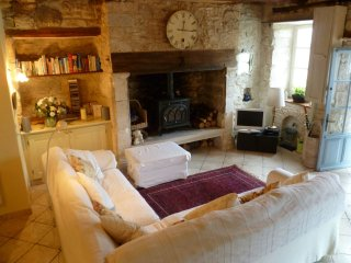 Sitting room with wood burning stove.