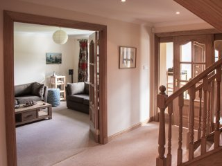 Entrance hall with access to living room, kitchen and downstairs bedroom