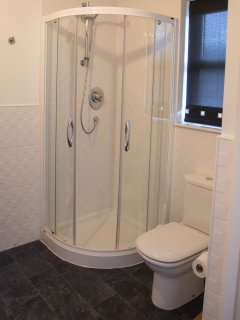 En-suite shower for downstairs bedroom, also accessible from hall.
