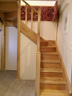 Climb the stairs to a sitting room, bedroom and bathroom