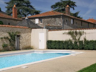 Character 2 bedroom cottage with pool, sleeping 4, rural village setting.