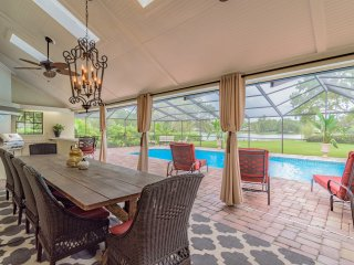 Large, Covered Lanai with Outdoor Kitchen & Dining with 14' Custom Table for 14