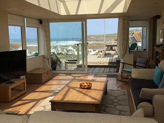 Huge sun lounge with lantern roof and triple aspect windows, views of the sea & cliffs & decking.