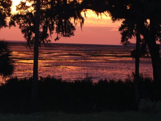 Sunrise at high tide from master bedroom, living/dining room, kitchen & porch.