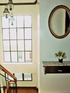 Impressive large foyer with Narra wood stairs