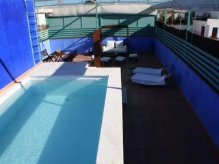 The Actor's House apartment in Macarena with WiFi, air conditioning, private par