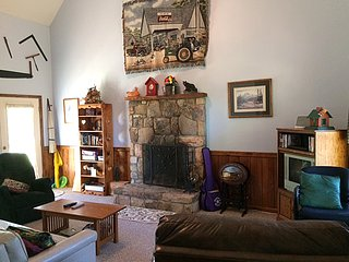 Wood burning stone fireplace and cable TV with plenty of entertainment to choose from.