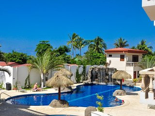Bright poolside condo with ocean views, modern amenities, & nearby beach!