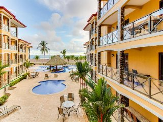 Elegant condo in beachfront property with shared pool and ocean views!