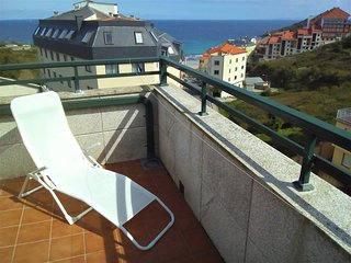 Apartamento con terraza y vistas al mar