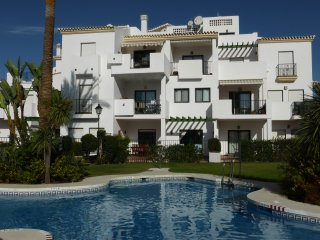 A Ground Floor Apartment on Alhaurin Golf, with Communal Pool