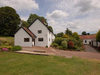 SURRIDGE FARMHOUSE, detached grade II listed farmhouse with hot tub. Sleeps 9.